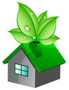 Eco house with leaves Stock Photo