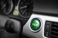 Eco mode button green on a dashboard of a sportive car Royalty Free Stock Image