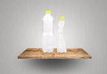 Eco plastic bottles on wood shelf save Royalty Free Stock Images