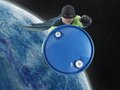 Eco superhero taking away blue container containing hazardous waste earth outer space Stock Photo