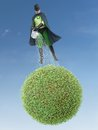 Eco superhero watering green planet above green environment concept Royalty Free Stock Photography