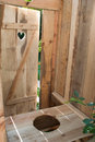 Eco toilet wooden outdoors in the garden Stock Photo