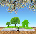 Ecological book with trees and house Royalty Free Stock Photo