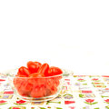 Ecological cherry tomatoes with copy space in glass tray on tablecloth and blank to text Stock Images