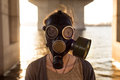 Ecological concept of air contamination. Woman in gas mask Royalty Free Stock Photo