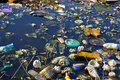 Ecological disaster river that is polluted with various garbage and trash photography Stock Photo