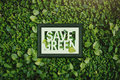 Ecology concept, Save green word inside wooden photo frame, surr Royalty Free Stock Photo