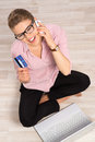 Ecommerce woman on line shopper sitting with laptop and paying by credit card portrait of person sitting at the floor at home and Royalty Free Stock Photos