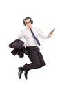 Ecstatic businessman listening music on his phone to cell isolated white background Royalty Free Stock Photo