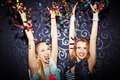 Ecstatic dancers two girls having fun in night club Royalty Free Stock Images