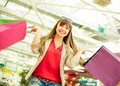 Ecstatic female joyful girl being satisfied with her lucky shopping Royalty Free Stock Photography