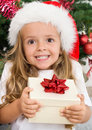 Ecstatic happy girl with christmas present Royalty Free Stock Photo