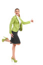 Ecstatic mid adult woman is standing on one leg shouting business dancing and showing thumb up full length studio shot isolated Stock Images