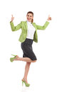 Ecstatic mid adult woman with thumbs up shouting business dancing on one leg and showing full length studio shot isolated on white Stock Photography