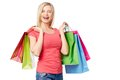 Ecstatic shopper portrait of joyful female with colorful paperbags over white background Stock Photos