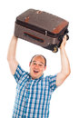 Ecstatic traveler lifting up his luggage passenger man isolated on white background Royalty Free Stock Image