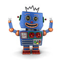 Ecstatic vintage toy robot super happy throwing both his arms up in the air Royalty Free Stock Photography