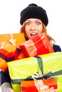 Ecstatic woman in winter hat with many gifts Royalty Free Stock Photography