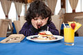 Ecstatic young boy eating a stack of pancakes Royalty Free Stock Photo