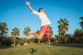 Ecstatic young casual man jumping of joy outside Royalty Free Stock Photo