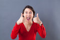 Ecstatic young woman shouting with thumbs up for excitement Royalty Free Stock Photo