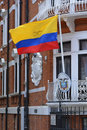 Ecuador flag flying outside embassy in london the republic of building with coat of arms of on plaque below Stock Images