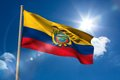 Ecuador national flag on flagpole blue sky background Stock Photos