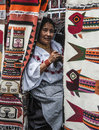 Ecuador otavalo indian woman in national clothes august ecuadorian ethnic women sells the products of his weaving as usual on Stock Image