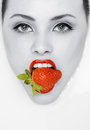 Ed lips with strawberry. Fashion toned portrait Stock Image