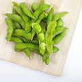 Edamame nibbles boiled green soy beans japanese food on white Stock Photos