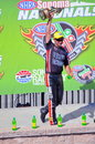 Eddie krawiec with trophy holds up his wally after winning at sonoma raceway Stock Photos