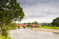 Eden bridge the road near lazenby is th century built from local red sandstone Royalty Free Stock Photos