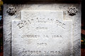 Edgar allan poe tombstone at gravesite with name and dates engraved Stock Images