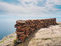 Edge of the cliff at palisade head this is with rocks stacked as a barrier this is in lake superior north shore in Royalty Free Stock Images