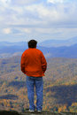 At the edge man standing of grandfather mountain in nc Royalty Free Stock Photo