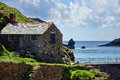 At the edge of the sea mullion cove old stone building in cornwall Royalty Free Stock Photography