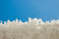 Edge of snow surface and blue sky Stock Images