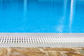 Edge of the swimming pool overflow with blue seawater Royalty Free Stock Image