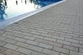 Edge Of Swimming Pool With Reflection And Concrete Paving Royalty Free Stock Photo