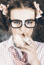 Edgy grunge portrait of a hipster nerd smoking cigarette in a depiction of cool Royalty Free Stock Image