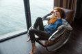 ?edhead woman relaxing on rocking chair Royalty Free Stock Photo