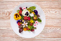 Edible flowers salad in a plate Royalty Free Stock Photo