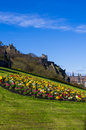 Edinburgh castle seen from the mound a view of with a garden in foreground Royalty Free Stock Photos