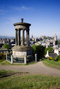 Edinburgh city and castle viewed from calton hill on a beautiful summer morning with the dugald stewart monument in the foreground Stock Image