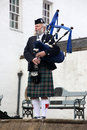 Edinburgh scotland united kingdom june unidentified sco scottish bagpiper playing music with bagpipe at on is Stock Photo