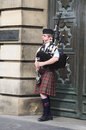 Edinburgh street bagpiper on the royal mile bagpipe players are one of symbols of scotland photo taken may th Royalty Free Stock Photography