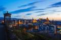 Edinburgh twilight skyline of at from calton hill with the silhouette of the dugald monument on the left of frame Royalty Free Stock Photos