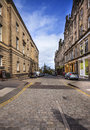 Edinburghs cobbled streent in the morning time Royalty Free Stock Photo