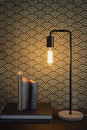 Edison filament table lamp and books home interior contemporary Royalty Free Stock Photography