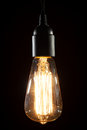 Edison light bulb on wooden background Royalty Free Stock Photo